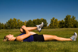Woman stretching gluteus maximus in park