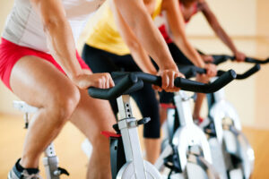 People using exercise bikes in gym