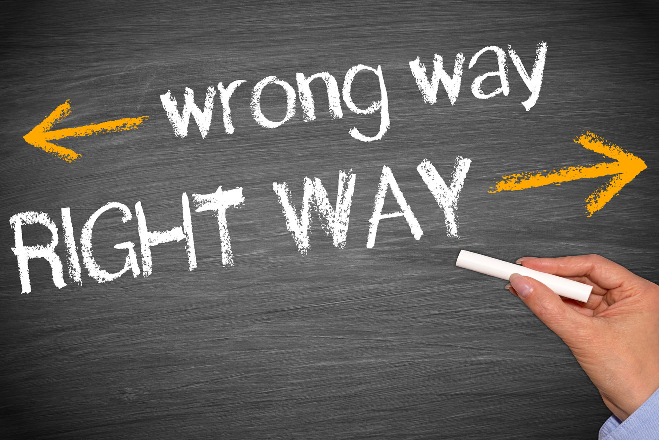 Right way and wrong way written on board