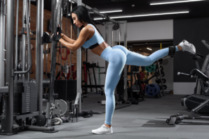 Woman doing cable hip extension exercise