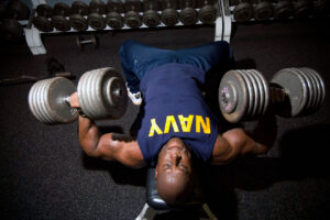 Soldier doing dumbbell bench press