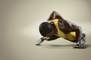 Black man doing push-ups with one arm