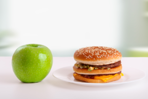 Green apples and Big Mac on table