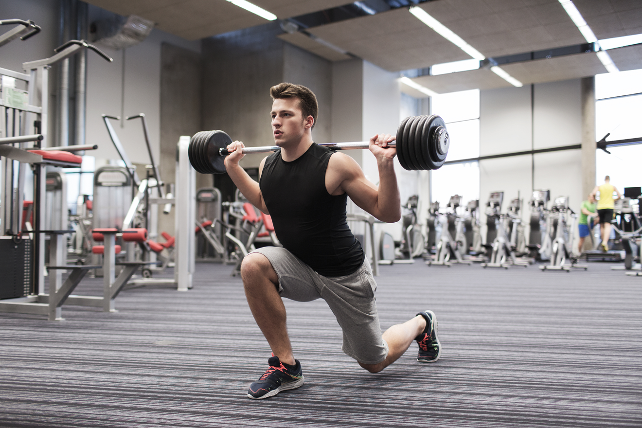Man doing barbell lunge