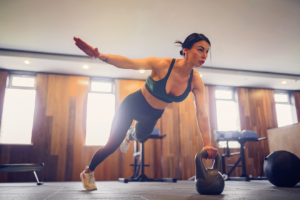 Woman with kettlebell in gym
