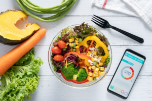 Phone with calorie-counting app on table