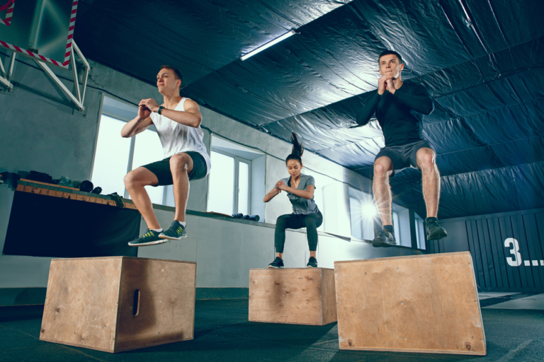 Man and woman doing a box jump exercise