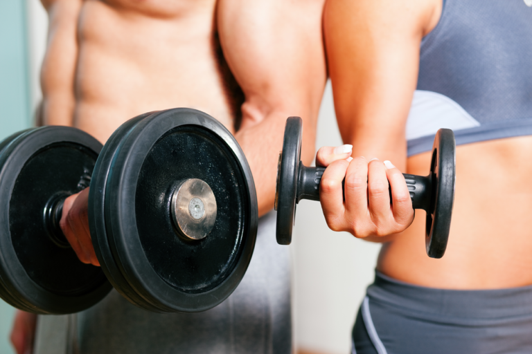 Man and woman holding a dumbbell