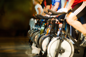People riding exercise bikes in a gym