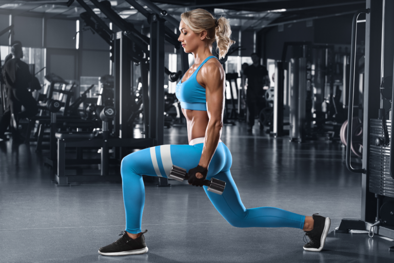 Woman doing dumbbell lunge in gym